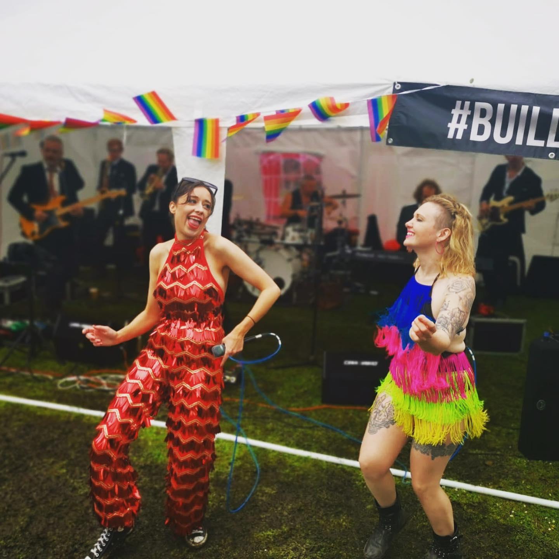 Tess and Tina loving the Pride show